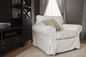 Slipcovered oversized chair with accent pillow.