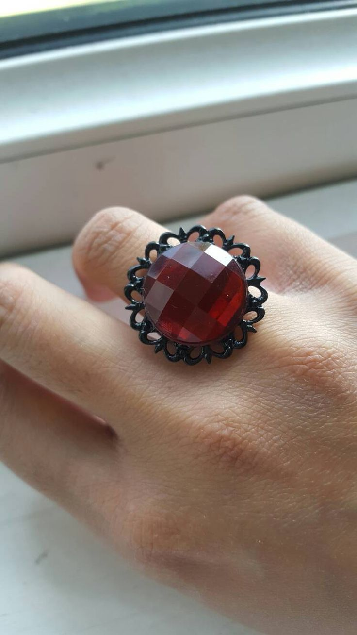 A personal favourite from my Etsy shop https://www.etsy.com/uk/listing/293425211/dark-red-gothic-cabochon-ring