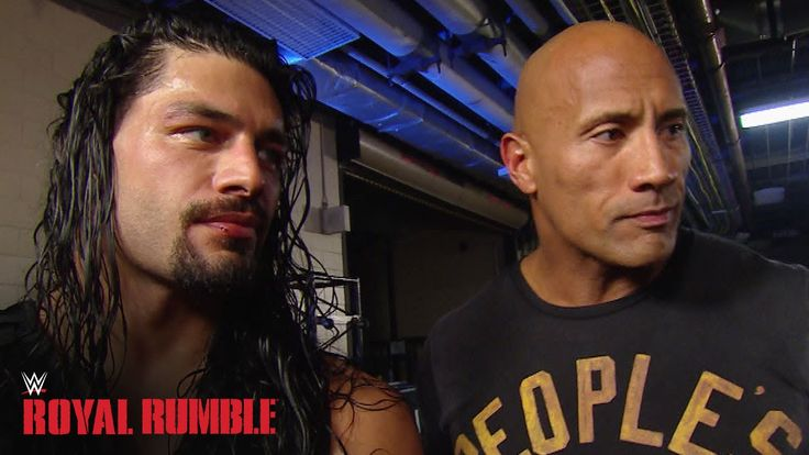 Roman Reigns celebrates with The Rock after winning the Royal Rumble Match - WWE...