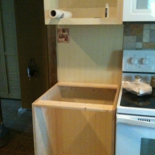 Cabinet boxes by stove .didn't have a cabinet here before.