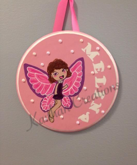 Personalized Circular Door by Kaithan Creations accented with a butterfly fairy.  Can be customized to your name, colors and theme.   Visit my Facebook page for more ideas. www.facebook.com/kaithancreations