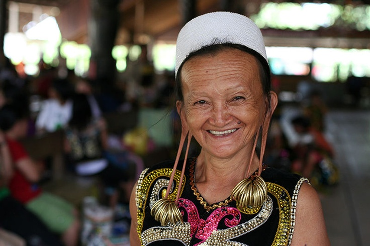 The Dayak people is the collective name for the indigenous inhabitants of Kalimantan. The most striking feature of many of the older Dayak women is their pierced ear lobes, stretched with the weight of heavy gold or brass rings. This custom is increasingly rare among the young. Older Dayaks, influenced by missionaries, often trim their ear lobes as a sign of conversion.