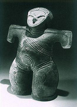 "The person who attaches a mask.   Japanese ceramic figurine ""DOGU"". Jomon period. BC.2,500 - BC.1,200.   Excavation place / Ushiroda Yamanashi Japan."