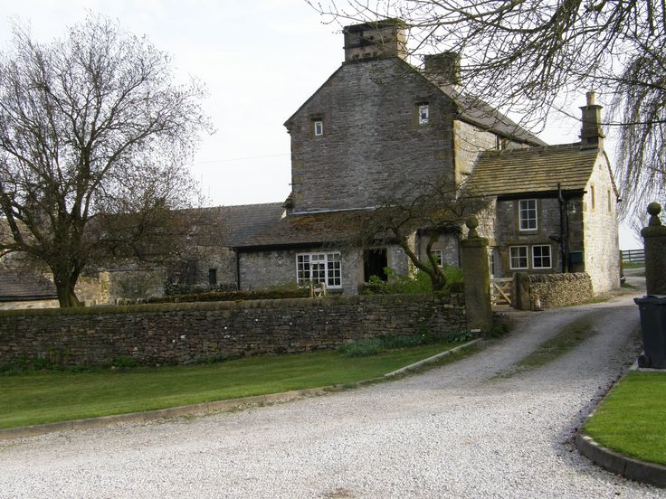 Foolow ~ Old Hall Farm dates back to 1630 and inside it still has cruck beams and two stone staircases.