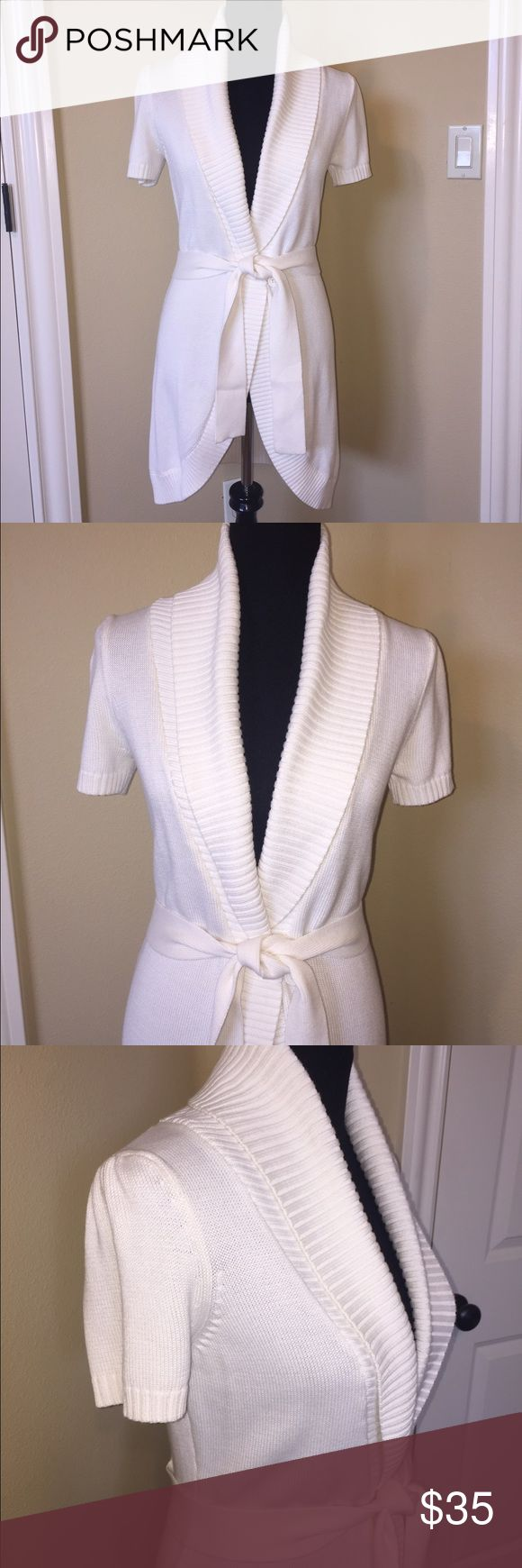 "INC Int'l Concepts Long Cardigan Sweater NWOT INC International Concepts long Cardigan Sweater NWOT. Short sleeves. Stunning cream colored sweater with belt.  Shawl collar and single button closure. Pleat detail on back by belt. Ribbed trim. 33"" length. 60% cotton/40% rayon. Size S. INC International Concepts Sweaters Cardigans"