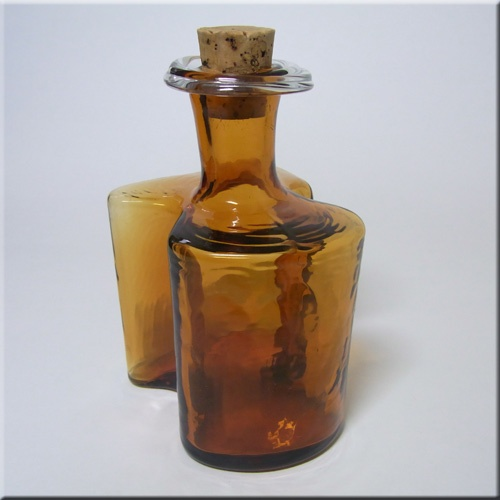 Holmegaard amber glass 'Hiverten' schnapps bottle with cork stopper, designed by Hjördis Olsson and Charlotte Rude.