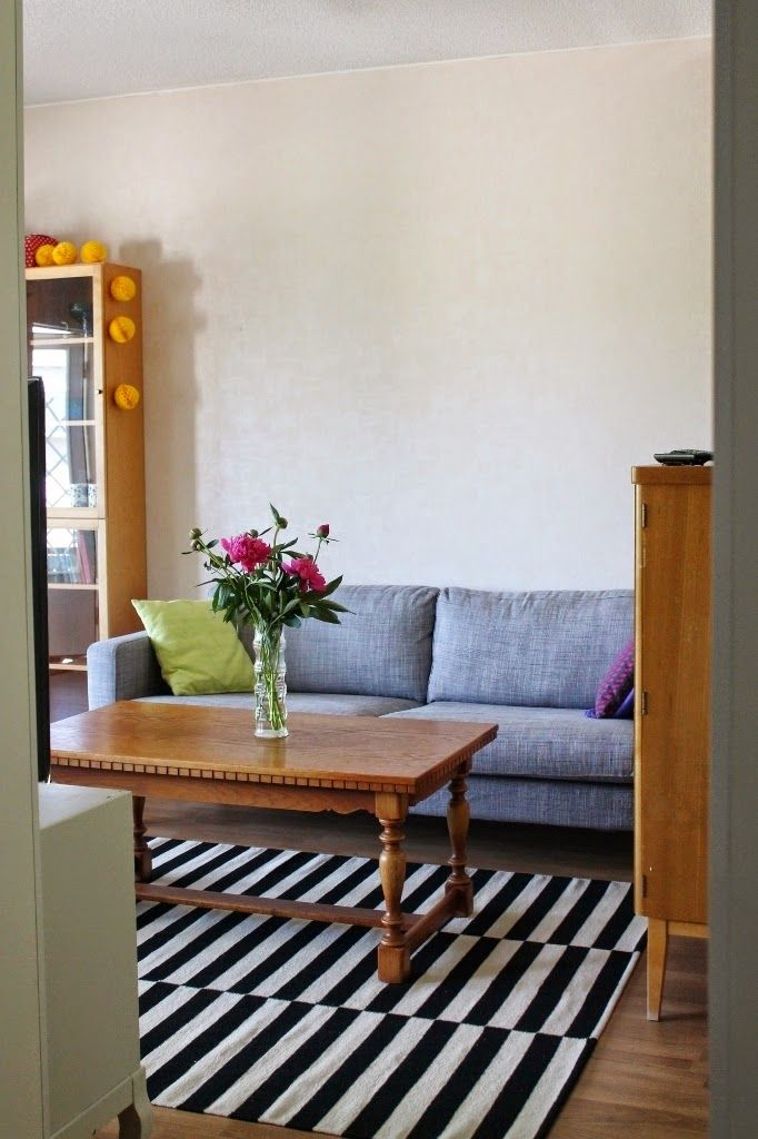 My living room. Ikea rug, old table and Ikea sofa.  http://omankatonalla.blogspot.fi/2014/07/olkkari.html