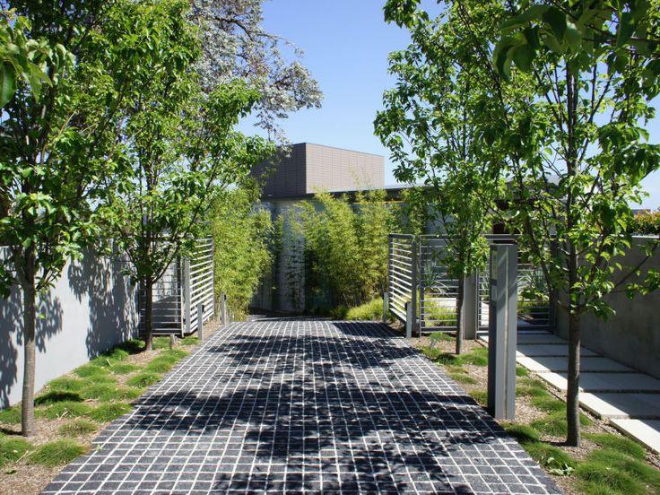 Eco Outdoor Raven granite cobblestone driveway.