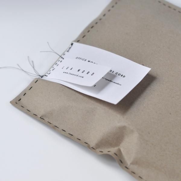 Self promotion idea. I have always loved the idea of sewing a closure - but in addition, you could sew your business card on the outside of a package/mailer