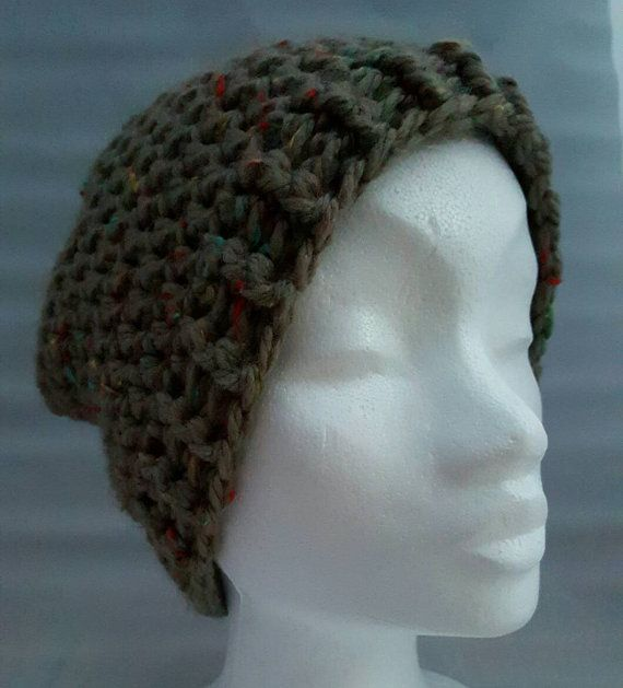 This is a hand crocheted was winter hat. Size suitable for a large head and very comfortable if you have a lot of hair like me!  A perfect gift for anyone in your life, or why not treat yourself! The simple design means it this hat is suitable for a woman or man.  Made from a neutral colour chunky yarn with flecks of blue, red and yellow yarn as shown in the fifth photo. The main colour of this hat is hard to describe as it changes depending on the light. Sometimes it looks grey and…