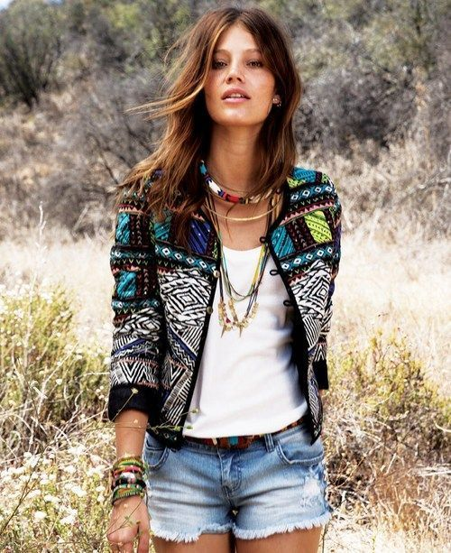 White tee with cutoffs with black embroidery jacket, lots of necklaces and bracelets give it a bohemian  look