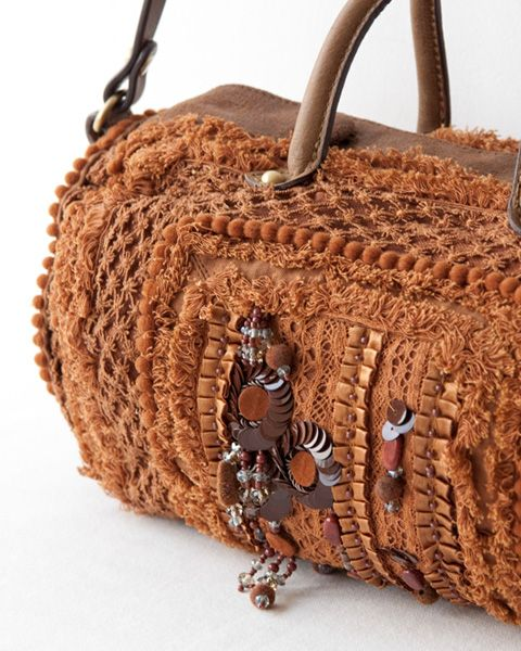 Made of raw-edged layers and lots of trim. Great ideas for texture on a bag - and a fun shape.