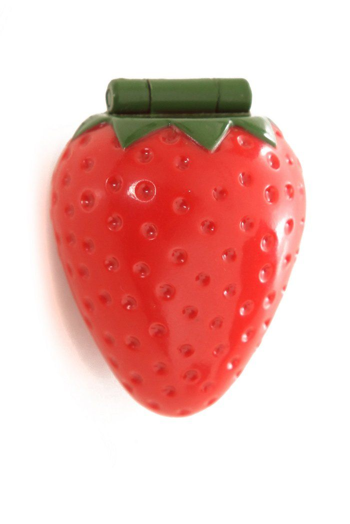Strawberry lip gloss.  I got it by making a trade with a girl in my class.  I loved that strawberry! lol