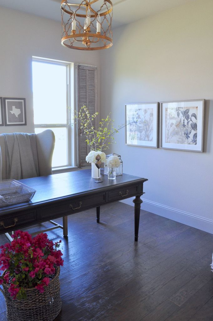 Home Office with Black Desk and Vintage Gray Interior Shutters