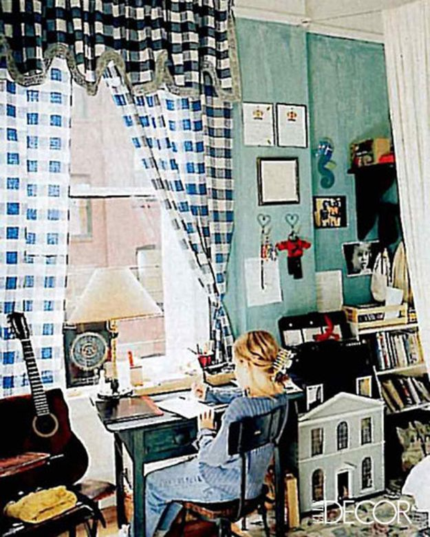Welcome to a 12-year-old Jemima Kirke's bedroom, featuring a dollhouse, teeny guitar, and checkered curtains. Jemima, is that you in the jumbo hair clip and ribbed sweater?