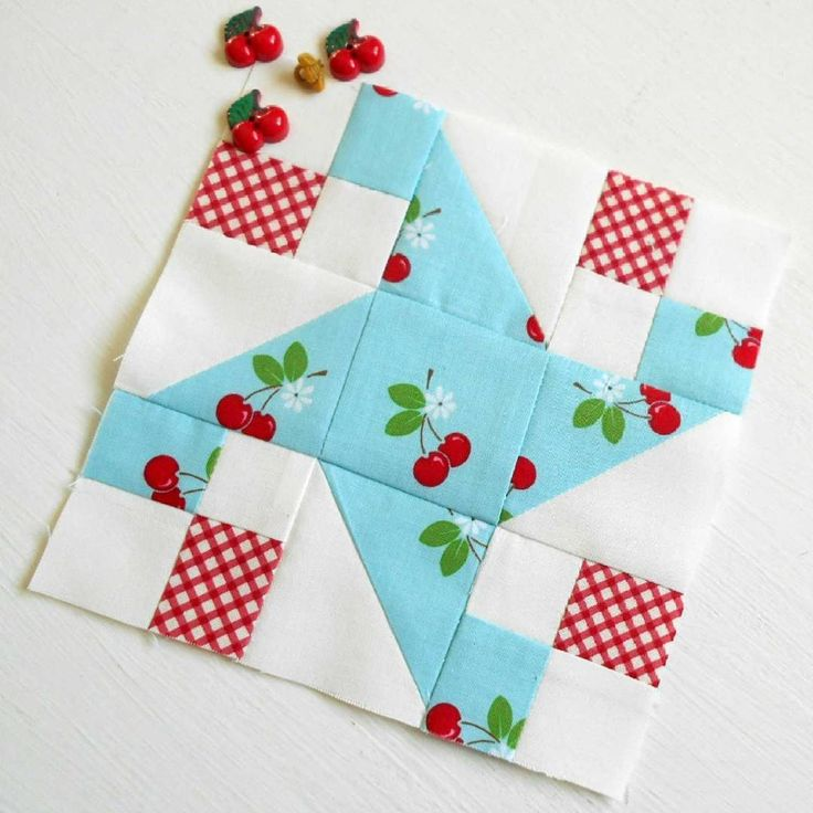 """Block 248 - Waterwheel.  This 6"""" waterwheel makes good use of the prettiest cherry fabric I have every seen."""