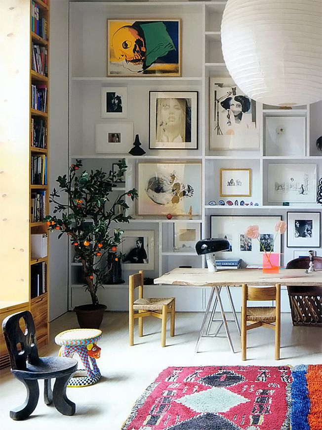 Bookcase staged with art and collectables for rooms without books.