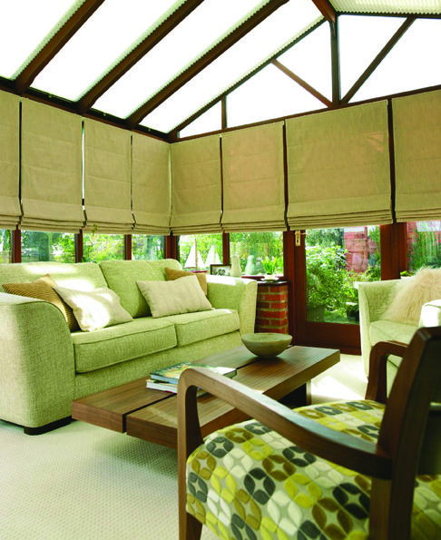 Hillary's blinds in a darkwood conservatory