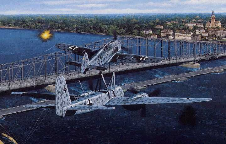 Typical of the attacks on the bridges at Küstrin was that on April 12, 1945. At 1825 hours that evening Second Lieutenant Hans Altrogge took off from Peenemünde in a Ju 88 of I/jK.G. 66, to act as lead aircraft for the attack. Four Mistel combinations followed him into the air, and the curious formation headed south towards the target. The view from the upper component Fw 190's was not good, and the Ju 88 pathfinder flew some two miles in front and 1,500 feet above the combinations, so as to…
