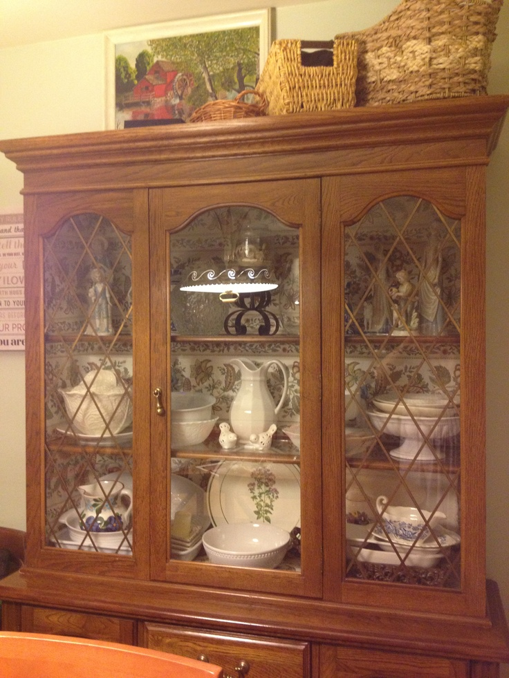 Old china cabinet given a new look thanks to pretty wallpaper - a great DIY project in less than an hour!
