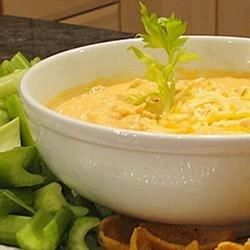 Five simple ingredients in your slow cooker make this creamy, cheesy, zesty hot dip that tastes just like Buffalo chicken wings.
