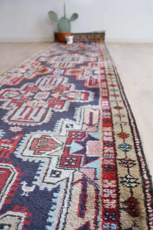Handgeknoopte vintage loper. Lang Perzisch tapijt/kleed uit Iran
