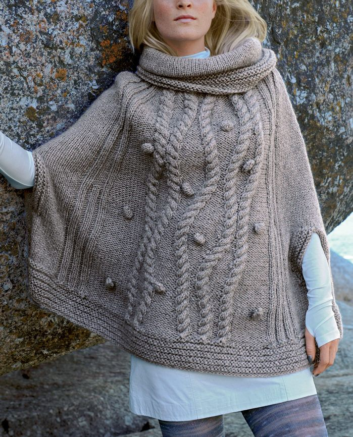 Free Knitting Pattern for Cabled Poncho - Cowl-neck poncho with armholes featuring winding braided cables and bobbles. Designed byBergère de France. Available in English and French.Two sizes: S/M and L/XL