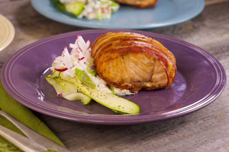 Bacon-Wrapped Salmon Filets with Ranch Sour Cream and Radishes.