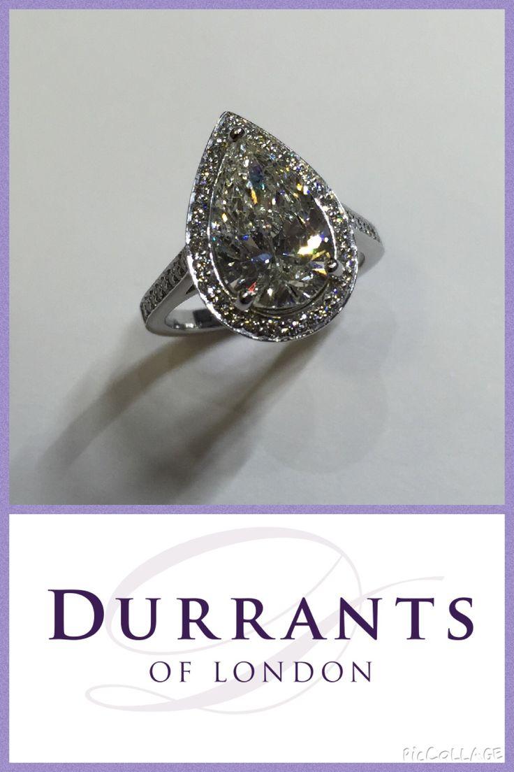 Pear shape platinum diamond halo ring!