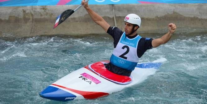 Tony Estanguet entre dans l'histoire du sport français en étant le premier à décrocher trois titres olympiques dans la même discipline. (AFP)
