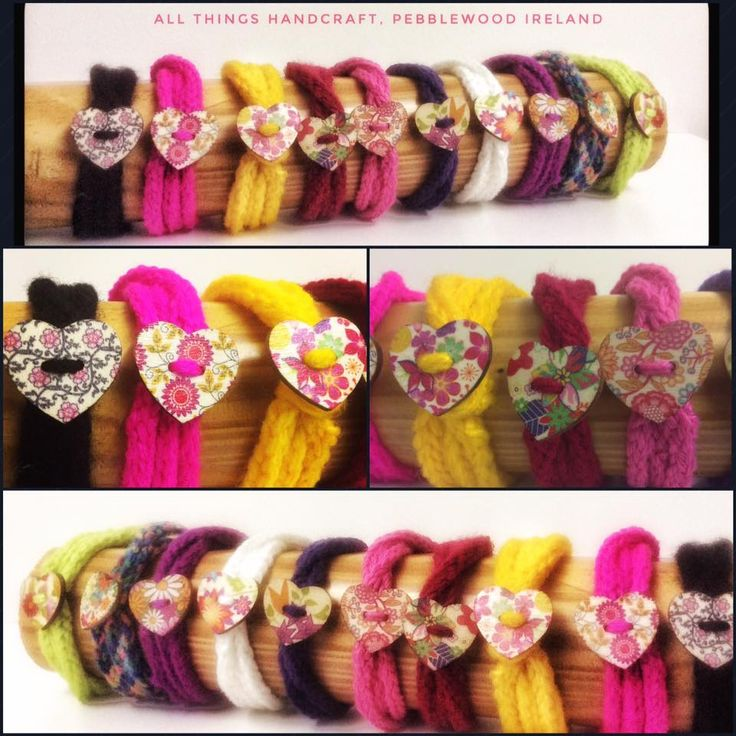 Hand knitted bracelets with wooden flowry heart buttons.