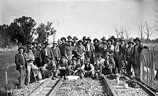 Ways and works crew replacing rails, Fernihurst district, circa 1915. Description: A group of railway employees of the Ways and Works branch posed for a photo. They were performing maintenance of the permanent way. Location: FERNIHURST, VICTORIA, AUSTRALIA Date: circa 1915 Railway workers, Fernihurst