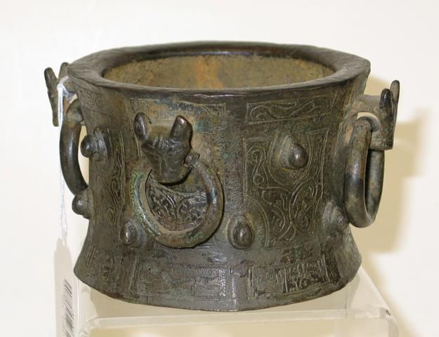 A Persian bronze mortar Sold for US$ 2,270 (RUB 129,622) inc. premium  AUCTION 14040: SOMA ESTATE AUCTION  19 Nov 2006