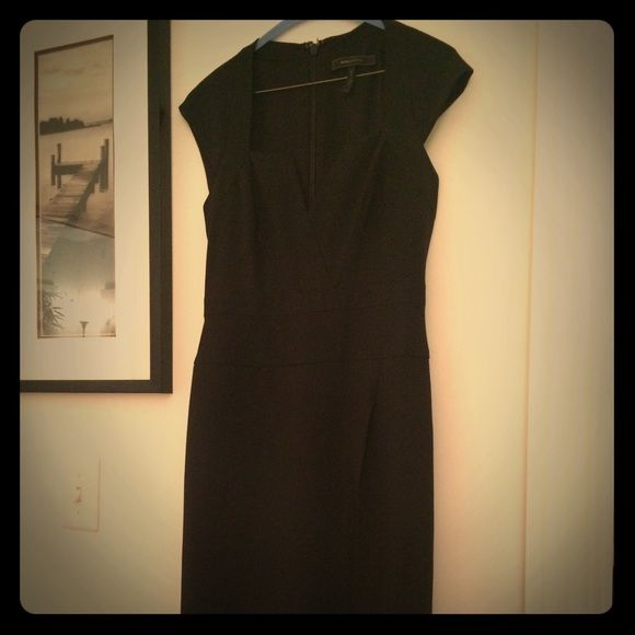 Beautiful BCBG Black Dress with Slit Beautiful brand new BCBG black dress with sweetheart neckline and slit. This dress was purchased brand new and worn 3 times for under 4 hours each time. Dry cleaned. Size 2 but I wear 2 - 6 depending on designer. An all season stunner! BCBGMaxAzria Dresses Midi