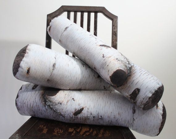 Love the trompe l'oeil effect of these birch pillows, perfect for winter... Or for playing fetch with a little dog...hehe..