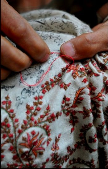 embroidering over printed fabric