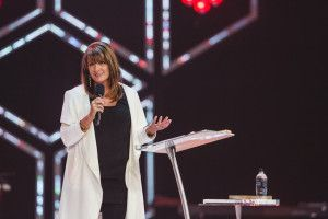 Bobbie Houston of Hillsong Church, Colour COnference in Sydney, 2015 with a Procson Pulpits Arc2 lectern and table.