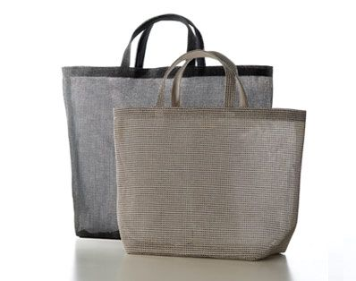 Woodnotes Beach Bag L and M. Woodnotes Accessories are made with Plain 100% paper yarn fabric.