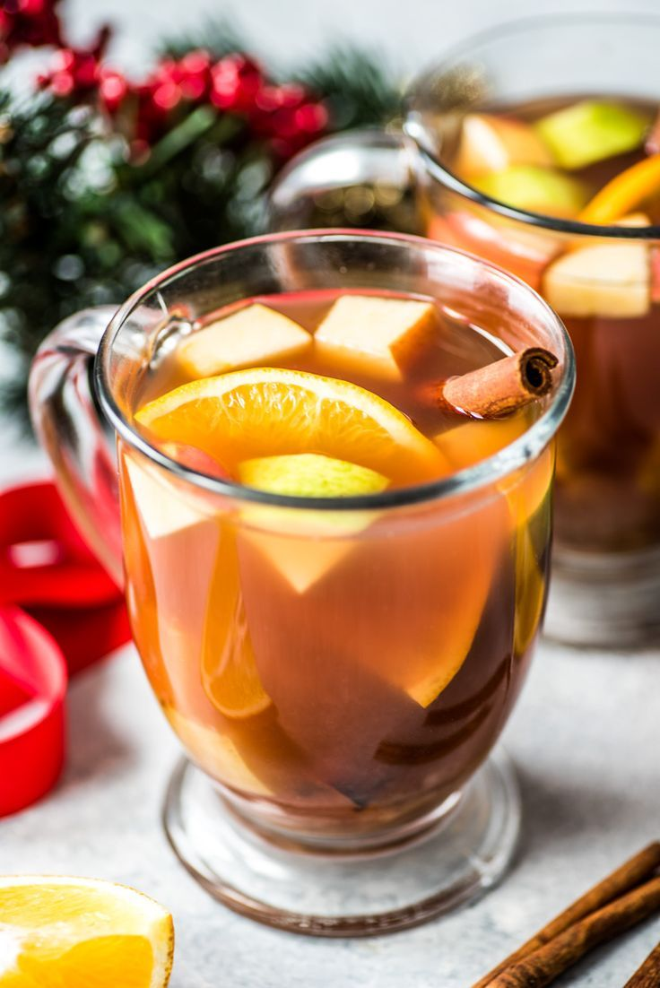 Mexican Christmas Ponche is a warm and comforting fruit punch made with apples, pears, oranges and guavas and spiced with cinnamon, cloves, tamarind and hibiscus. #ponche
