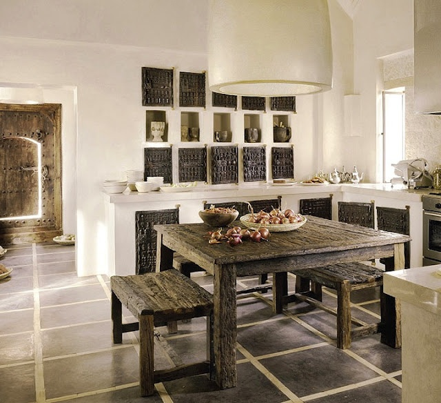 WOW.  what a gorgeous space.  Culled from French By Design: Dogon (Mali) carved doors for kitchen cabinets.