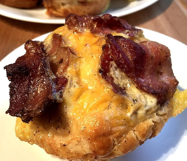 Awesome tasting and easy too! I always keep a tube of Pillsbury Grands Homestyle refrigerated buttermilk biscuits in the fridge and this is the recipe I make most often. You literally can use anything you have handy in your refrigerator to make these Bacon and Egg Breakfast Cupcakes taste different every time! Also, depending on who you are feeding, you can make each one different to accommodate different tastes. Eggs, bacon and cheese. A perfect combination. You have to give these a try…