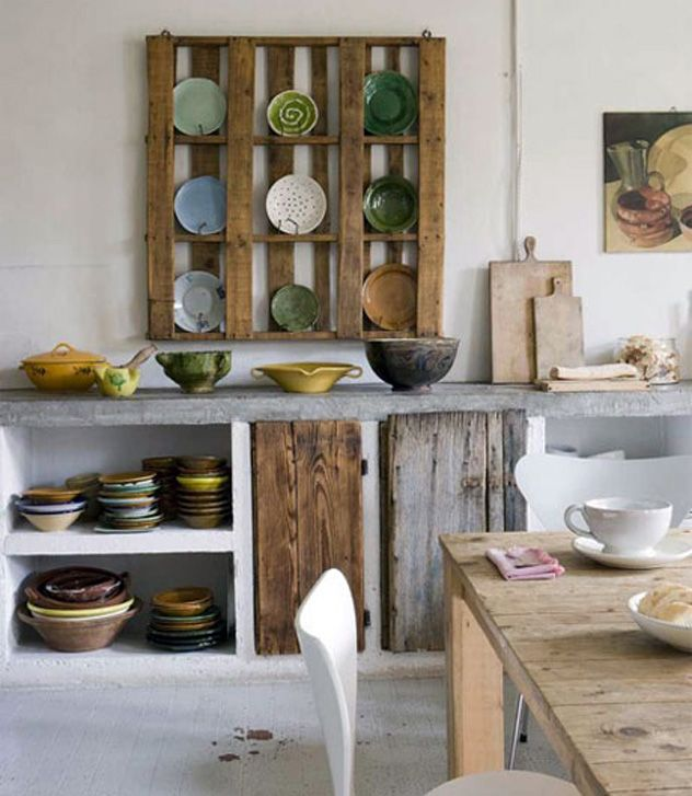how freakin cool would it be to use reclaimed wood for all the cabinets in your kitchen??