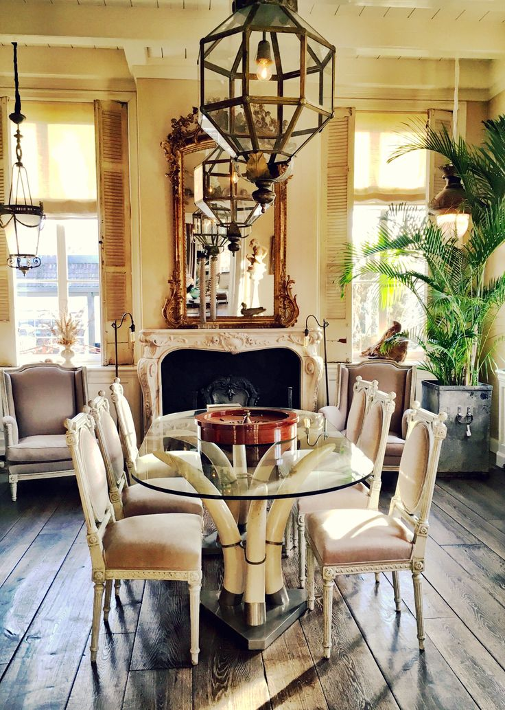 Dining room, table, chairs, interior, vintage, antique, design, old wooden floorboards, lanterns, fireplace, mantle piece, antique mirror, palm tree