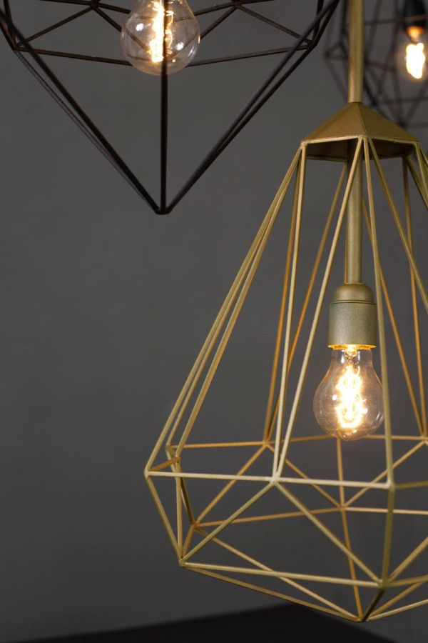 Diamonds is a series of hanging pendants designed by Sylvie Meuffels for JSPR that cross industrial with a bit of classy elegance. Much like the stones they're named after, these eye-catching lights will shine from the ceiling they hang from.
