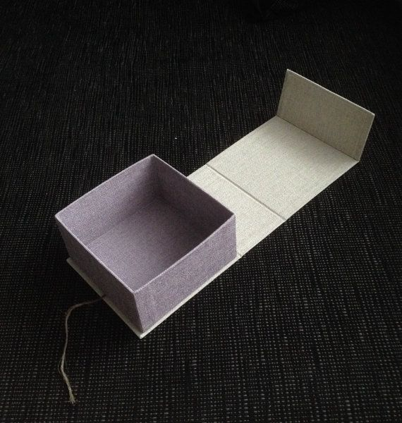This box is made of cardboard and high quality decorative paper of two different pattern in lavender and light grey colors , complete with button and linen wire.The dimensions of this box are 11x11 cm high 5.5 cm (outside).  All boxes that you can see in my Etsy shop are my handmade. Paying close attention to the product quality, using high quality materials. The box useful for packaging gifts, wedding envelop, photos, jewelery etc.  There are many possible variations, dimensions and colors…