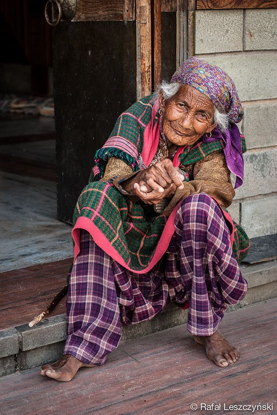 Old indian lady with deep wrinkles resting on a door step to hindu temple, India - travel / art / boho / asian / photo / print / wall decor
