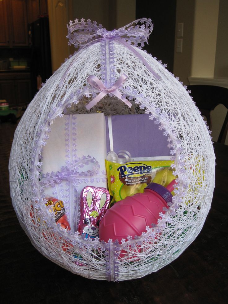 Lacy handmade easter egg basket.  We used to make these when I was little.  Blow up a balloon.  Make paste of flour/water.  Wet some white string or yarn and wrap, wrap, wrap.  When dry, cut out the hole and decorate.