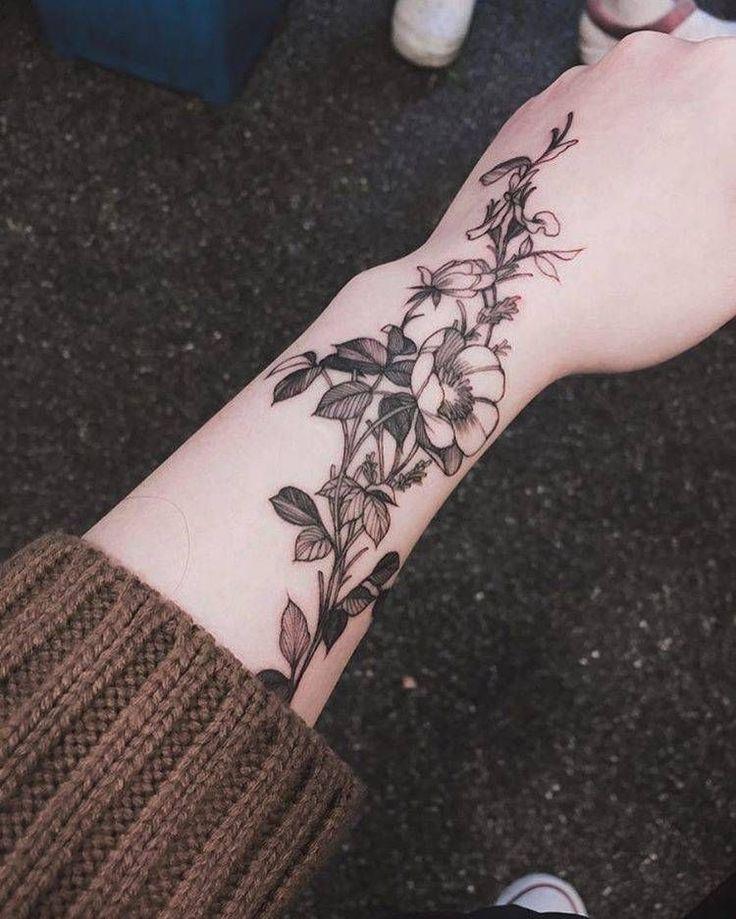 Healed flower tattoo on the left arm. Tattoo Artist: Zihwa (Vegan Tattoo Ideas)