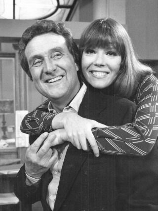 lotsofbrolly:  Patrick Macnee is being hugged by Diana Rigg!!!! :-D :-D :-D  Awwwww! They're so cute!
