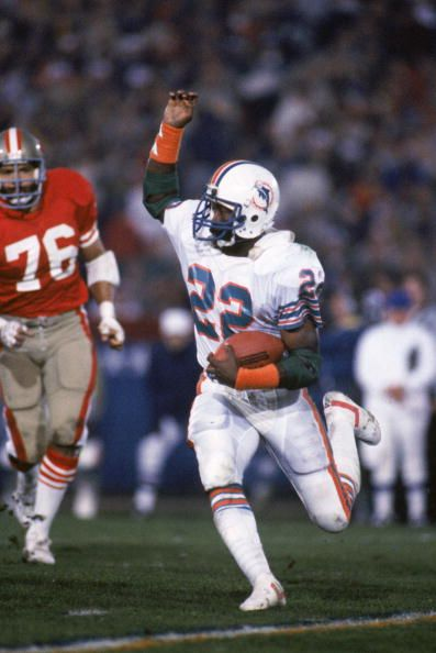 Running back Tony Nathan of the Miami Dolphins rushes for yards during Super Bowl XIX against the San Francisco 49ers